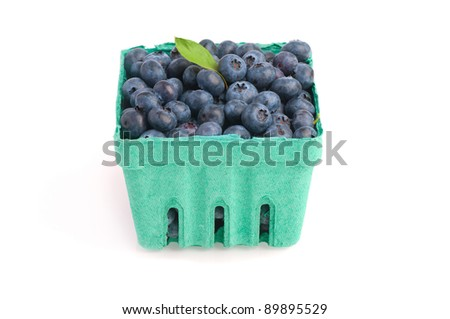 A Basket Full of Freshly Picked Blueberries Chock Full of Heart Healthy Good Nutrition on White Background with Room for Text or to be Used in Your Design or Arrangement - stock photo