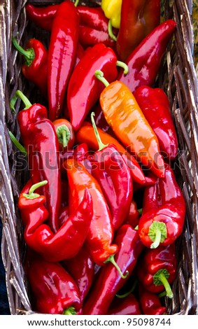 A basket full of red hot peppers at the farmers market - stock photo