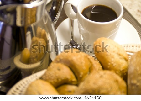 A Basket of bread with fresh coffee. - stock photo