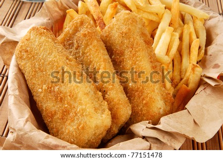 A basket of breaded fish sticks and french fries