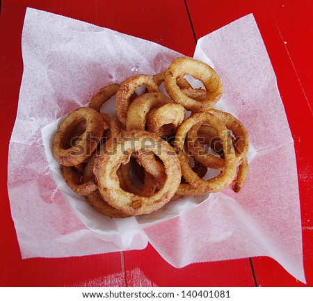 A basket of fried onion rings - stock photo