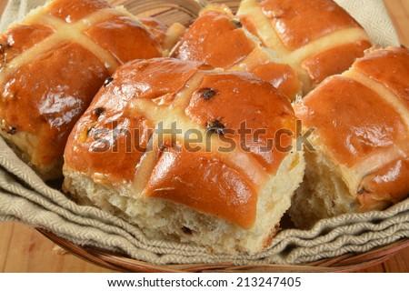A basket of hot cross buns closeup, a food associated with Good Friday - stock photo