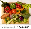 A basket overflowing with delicious fresh vegetables - stock photo