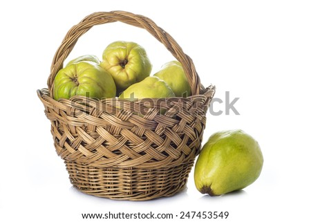 A basket with fresh quinces isolated on white background to make jelly and desserts in the kitchen - stock photo