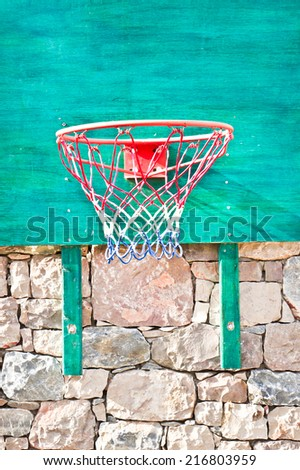 A basketball net on a green board - stock photo