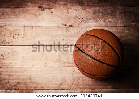 A basketball on a wood - stock photo
