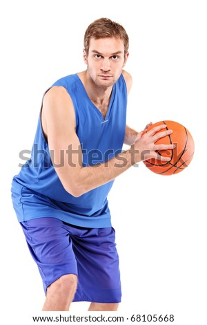 A basketball player posing with a ball isolated against white background