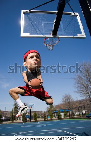 A basketball player with a large head driving to the hoop with some fancy moves. - stock photo