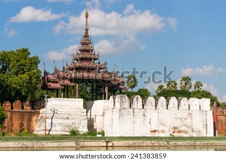 A bastion at the palace walls of Mandalay Palace - stock photo