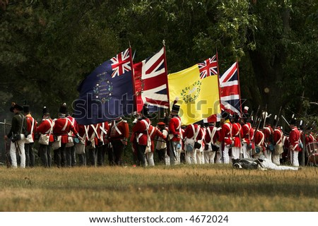 A battalion of British soldiers line up to attack during a War of 1812 battle re-enactment