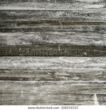 A battered old weathered wooden wall with scratched faded horizontal plank panels. Textured wood grain abstract background with copy space. - stock photo
