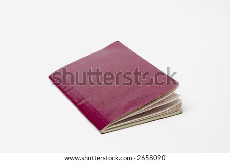A battered well used passport - stock photo