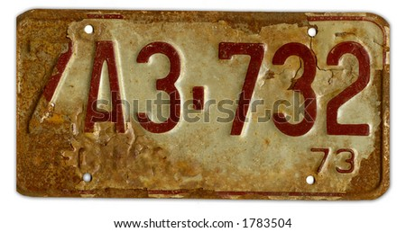 a battererd worn grungy rusty number plate - stock photo