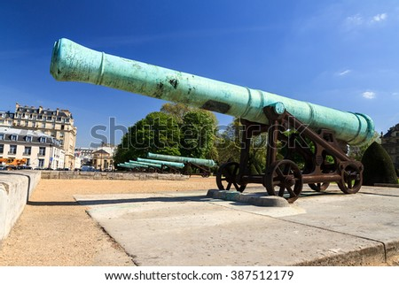 A battery of ancient cannons at Les Invalides in Paris, France, on a beautiful day in spring
