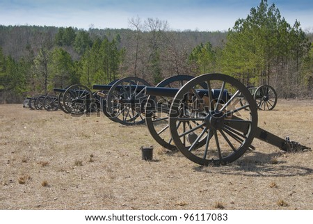 A battery of civil war cannon lined up. - stock photo