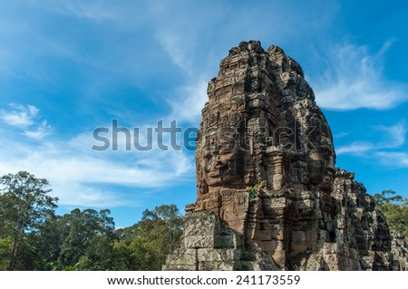 A bayon face at Angkor, Siem Reap, Cambodia. - stock photo