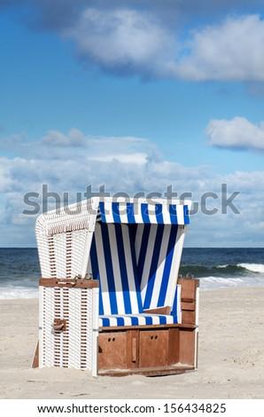 a beach basket on the beach of Sylt - stock photo
