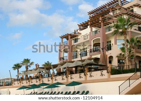 A beach-front condominium resort in Cabo San Lucas, Mexico. - stock photo