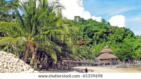 A beach front of a tropical resort - stock photo