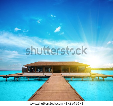 A beach house floating on the water in Maldives - stock photo