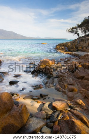A beach in a remote part of the Freycinet Peninsula in Tasmania - stock photo