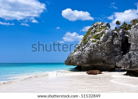 A beach paradise in Tulum, Mexico. Turquoise water and deep blue sky. - stock photo