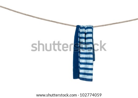 A beach towel hanging on a rope isolated on a white background. - stock photo