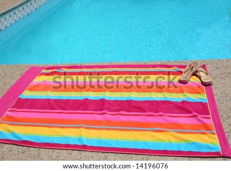 a beach towel poolside - stock photo