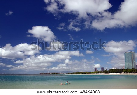 A beach view of Honolulu city in Hawaii. - stock photo