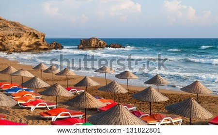 A beach view on a sunny day in Mediterranean coast - stock photo
