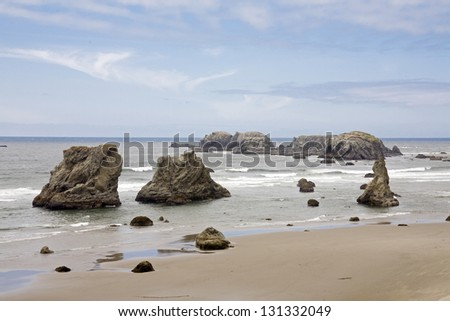 A beach view with rocks in the sea - stock photo