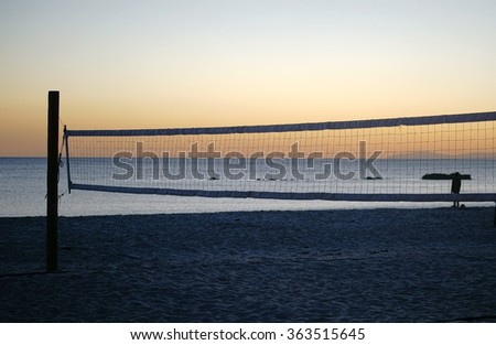 A beach volleyball court with a volleyball net on the beach of Long Beach during sunrise / Beach Volleyball     - stock photo