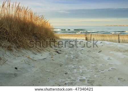 A beach with a golden glow after the sunrise. - stock photo