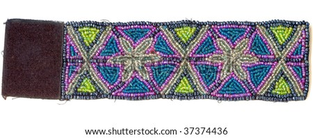 a bead bangle with a luxurious decorative pattern is isolated on a white background - stock photo