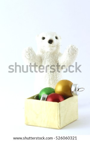 a bear with a box of christmas balls