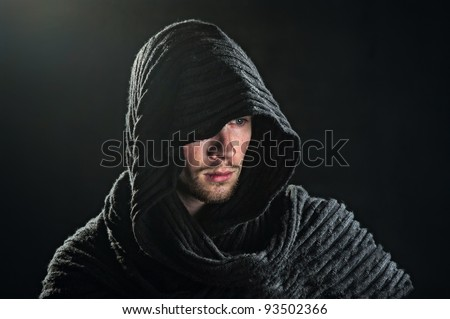 a bearded man in a hood - stock photo