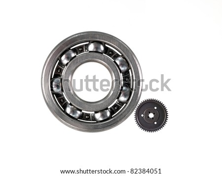 A bearing and gear cog isolated against a white background