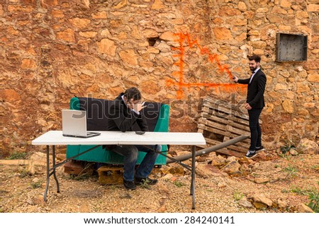 A bearish chart being drawn with graffiti on a ruin wall, a financial crisis concept - stock photo