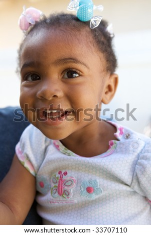 A Beautiful African American Baby smiling at the camera - stock photo