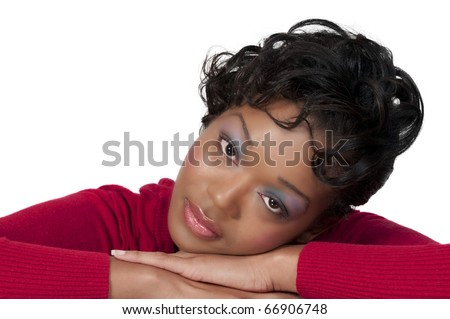 A beautiful African American black woman laying her head down - stock photo