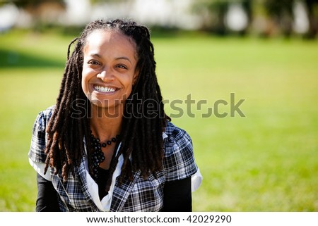 A beautiful African American with candid smile - stock photo