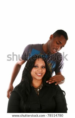 a beautiful african american woman has her hair attended to by her favorite hair stylist for a photo shoot in a studio. isolated on white with room for your text. focus on the woman - stock photo