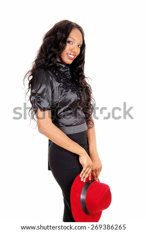 A beautiful African American woman in a black skirt and blouse holding a