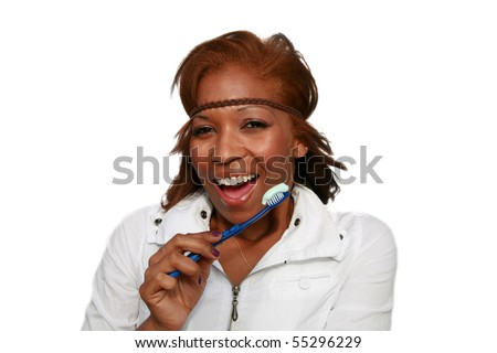 a beautiful african american woman is excited about brushing her teeth,  isolated on white - stock photo