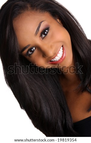 a beautiful african-american young woman with a pretty smile and gorgeous eyes against a white background - stock photo