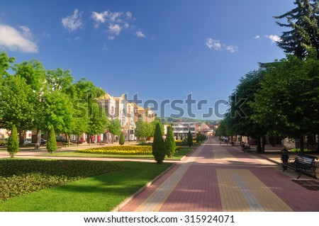 A beautiful alley with flower beds in the resort town. Kislovodsk. Russia - stock photo