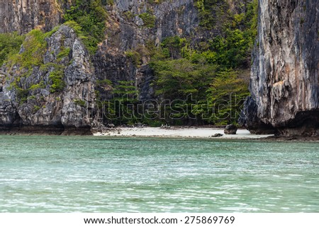 a beautiful an secluded cove in the exotic phi phi tropical island, Thailand - stock photo