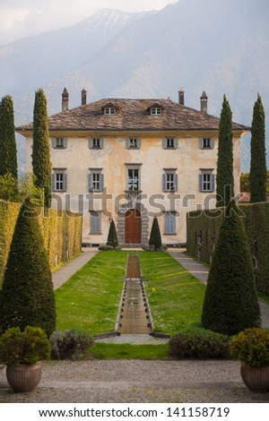 A beautiful ancient villa on the shores of Lake Como in Italy - stock photo