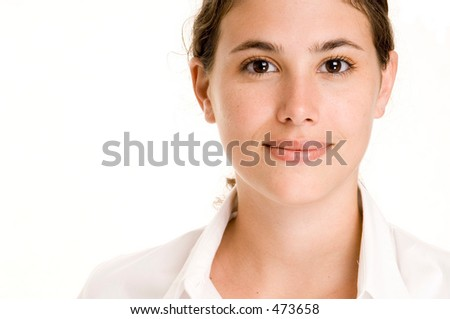 A beautiful and natural young woman in white on white - stock photo