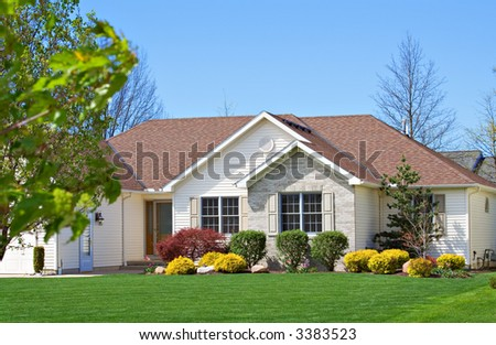 A beautiful and neatly groomed home in suburb of Ohio. - stock photo